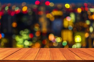 Wood table top on bokeh light