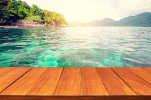 Wood table top on tropical ocean