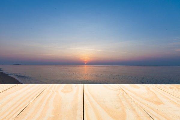 Wood table top on sunrise