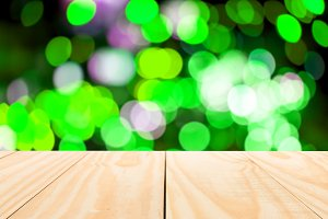 Wood table top on abstract bokeh