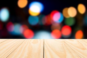 wood table top on light bokeh