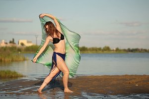 Dancing girl on river bank