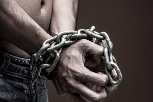 Chained man hands