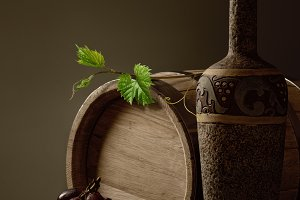 bottle wine and a wooden barrel