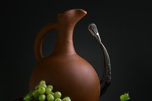 cup of wine pitcher