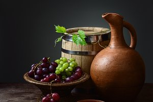 pitcher wine and wooden barrel