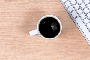 Dark Cup of Coffee on Desktop