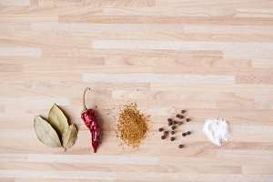 Spices on light wooden background