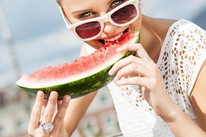 Beautiful girl with watermelon.