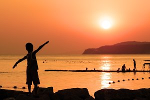 Silhouette of child against sunset