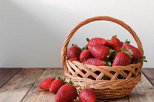 ripe strawberries in a wicker basket