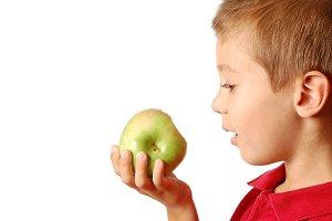 Child eats green apple