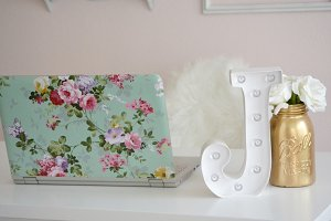 Feminine Stylized Desk Laptop Stock