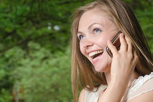 joyful woman with phone
