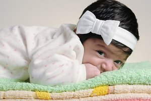 baby lying on a towel