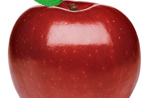 Ripe red apple with a green leaf