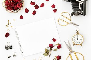 Flat lay photo album red rose