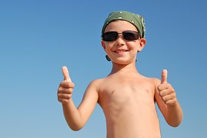 Happy child with thumbs up