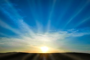 Sun rising above the land