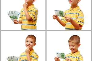 Happy child holding money in hand