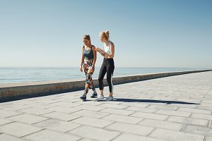 Couple female running exercising jogging happy on waterfront tra