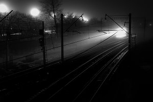 lights of the train in the night black and white. Contrast railways