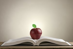 book with a red Apple