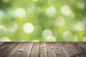 terrace of wooden planks on bokeh background