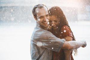 couple kissing under summer rain