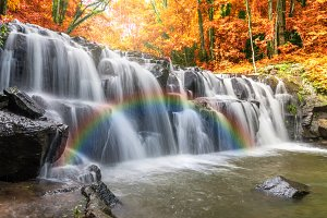 waterfall in the forest with rainbow