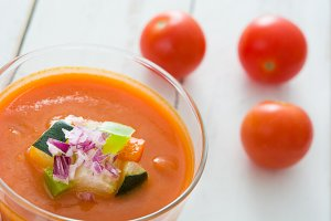 Gazpacho soup on white wooden table