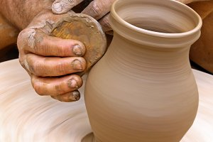 Making clay pottery