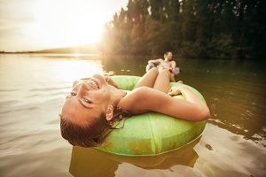 Young woman relaxing on inner tube