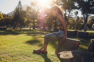 Sportswoman working out in park