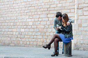 Couple looking smartphone
