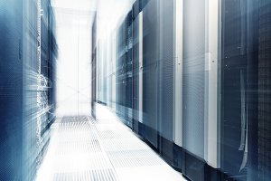ranks of modern server hardware in data center with blur and motion