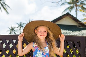 Cute lady in sun straw hat.