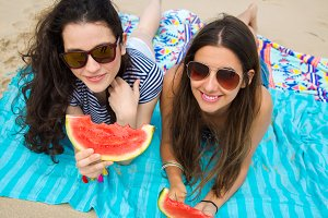 Young women eating watermelon