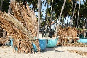 Fishing boats on tropical beach