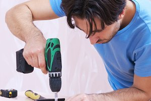 carpenter with drill