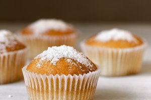 homemade baking muffins over white wooden board