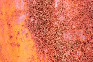 Rusty texture on painted metal