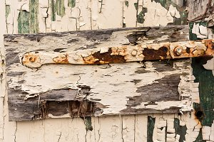 Rusty hinge on wooden door