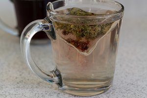 Tea bag or herbal drink in glass cup