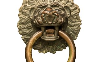 Lion head door knocker against white