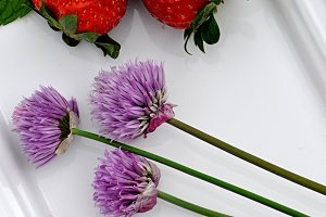 strawberries and purple flowers