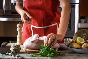 Unrecognizable woman cooking chicken