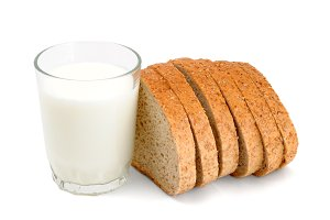 Glass of milk and sliced bread