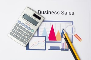 Business sales graph with calculator