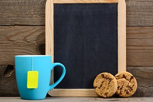 Cup of tea, cookies and blackboard